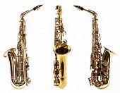 stock photo of saxophones  - Golden saxophones isolated on white - JPG