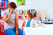 pic of scared  - family playing in doctor and patient father scared of injection - JPG