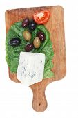 image of cheese platter  - roquefort cheese on wooden platter with olives and tomato isolated over white background - JPG