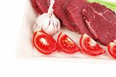 picture of white asparagus  - fresh raw beef meat steak fillet on wooden plate with asparagus and tomatoes ready to prepare isolated over white background - JPG