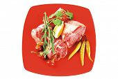 image of red meat  - fresh raw beef red meat fillet medallion chunks on red plate isolated over white background - JPG