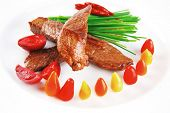 picture of chives  - hot fresh grilled red beef meat fillet with vegetables  green chives and peppers on china plate isolated over white background - JPG
