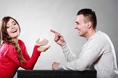 foto of amusement  - Happy couple talking and laughing on date - JPG