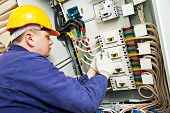 image of assembly line  - electrician builder at work with tester measuring high voltage and current of power electric line in electical distribution fuseboard - JPG