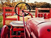stock photo of hayride  - The tractor sits silently awaiting a hayride - JPG