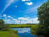 picture of wind-farm  - agrarian landscape with wind farm and pond - JPG