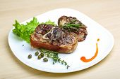 picture of roasted pork  - Roasted pork knee with thyme rosemary and salad leaves - JPG