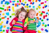 stock photo of twin baby girls  - Child playing with colorful toys - JPG