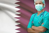 stock photo of qatar  - Surgeon with flag on background conceptual series  - JPG
