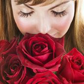 picture of red rose flower  - Woman with red roses - JPG