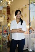 portait of small business owner: proud woman and her store
