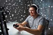 technology, gaming, entertainment, lets play and people concept - young man in headset with control poster