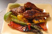 Plate Of Bbq Chicken And Vegetables