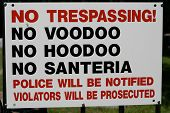 stock photo of fundamentalist  - Very unique No Trespassing sign on the front gate of a cemetery in the southern United States - JPG