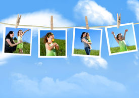 picture of mother child  - Family photographs hanging on a clothesline against a blue sky - JPG