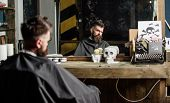 Man With Beard Covered With Black Cape Sits In Hairdressers Chair In Front Of Mirror. Hipster With B poster
