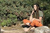 image of rastafari  - hippy preparing - JPG