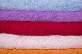 Stacked Colorful Towels, Background Of Colored Towels Stacked poster