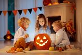 Kids Carving Pumpkin On Halloween. Trick Or Treat. poster