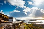 Tourist Bus Traveling On Mountain Road. Ring Of Kerry, Ireland. Travel Destination poster