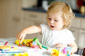 Adorable Cute Little Toddler Girl With Colorful Clay. Healthy Baby Playing And Creating Toys From Pl poster