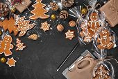 A Christmas Gingerbread Cookie In The Shape Of A Christmas Tree In A Cellophane Packing On The Backg poster