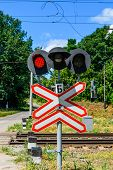 Railroad Crossing Sign And Blinking Semaphore In Front Of Railroad Crossing poster