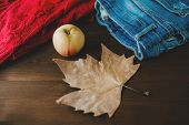 Flat Lay Of Autumn Fall Warm Clothes Cup Of Coffee And Autumn Leaf Over Wooden Background. Autumn Fa poster