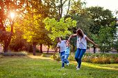 Happy Family Spending Time Outdoors Playing In Park. Mom Having Fun With Two Kids. Family Values poster