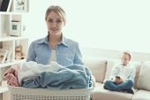 Young Smiling Woman Holds Basket Of Clean Clothes. Young Smiling Mother Holding Basket Of Clean And  poster