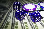 Stack Of Poker Chips With Blue Dice Rolls On A Dollar Bills, Money. Poker Table At The Casino. Poker poster