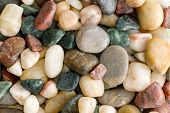 Background Texture Of Assorted Colorful Natural Smooth Waterworn Beach Pebbles, Rocks Or Stones Tumb poster