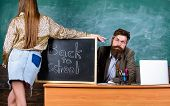 Student Girl Seduces Experienced Teacher. Teacher Strict Sit Table Chalkboard Background. Student In poster