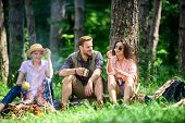 Camping And Hiking. Company Friends Relaxing And Having Snack Picnic Nature Background. Company Hike poster