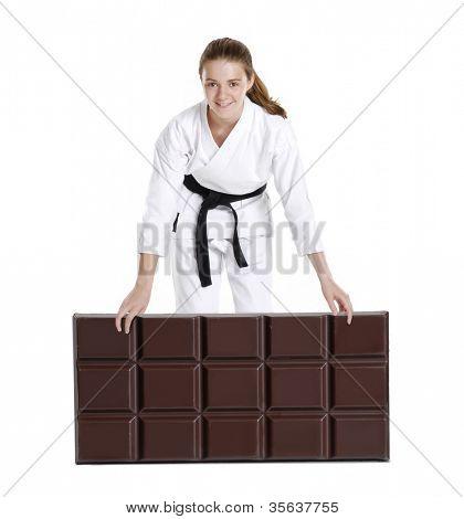 Постер, плакат: Боевых искусств девочка держит большой шоколадный bar karate девушка портрет Боевых искусств и Карате кид текст , холст на подрамнике