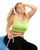 stock photo of anorexia nervosa  - Depressed overweight woman measure her waist belly by metre - JPG
