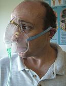 Man Wearing An Oxygen Mask