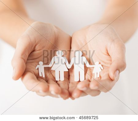 close up of womans cupped hands showing paper man family poster