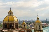 stock photo of guadalupe  - Old basilica of Guadalupe with Mexico City cityscape in the background - JPG