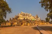 stock photo of nu  - The Maha Aungmye Bonzan Monastery well - JPG