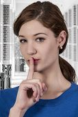 picture of shhh  - A woman saying be quiet by saying shhh - JPG