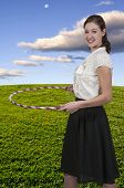 pic of hulahoop  - Young beautiful woman with a hula hoop - JPG