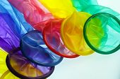 pic of std  - set of condoms of different colors on a white surface - JPG