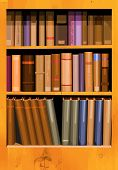 stock photo of book-shelf  - A collection of books in a bookcase in vector format - JPG