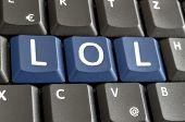 stock photo of lol  - Abbreviation LOL written with blue keys on computer keyboard - JPG