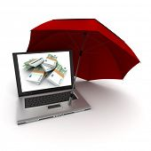 Laptop with hundred euro bills on the screen, protected by an umbrella
