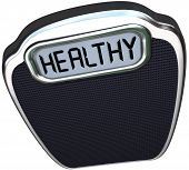 The word Healthy on a scale to illustrate being in good health and shape through diet and exercise t