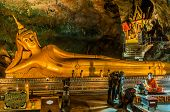 PHUKET ISLAND, THAILAND - AUGUST 12, 2008: statue of Reclining Buddha in buddhist suwankuha temple p