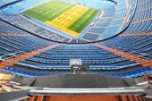 MADRID - MAR 8: Grandstand and artificial light for growing lawns in Santiago Bernabeu Stadium - are
