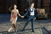 picture of tango  - young couple dancing tango on the streets of the old city - JPG